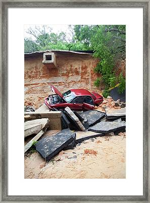 Car And Road Washed Out By Flooding Framed Print by Jim Edds