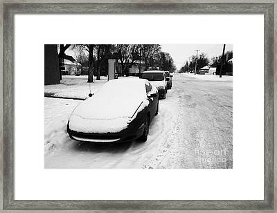 car covered in snow parked on street in pleasant hill Saskatoon Saskatchewan Canada Framed Print by Joe Fox