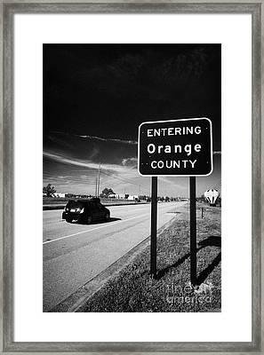 Car Entering Orange County On The Us 192 Highway Near Orlando Florida Usa Framed Print by Joe Fox