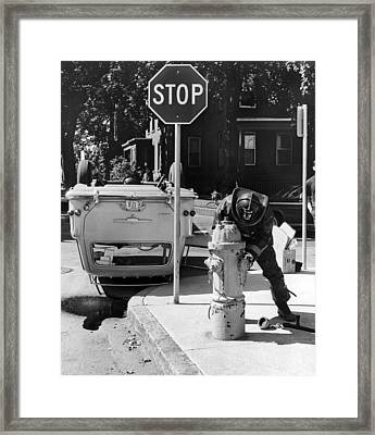 Car Flips Over At Stop Sign Framed Print by Underwood Archives