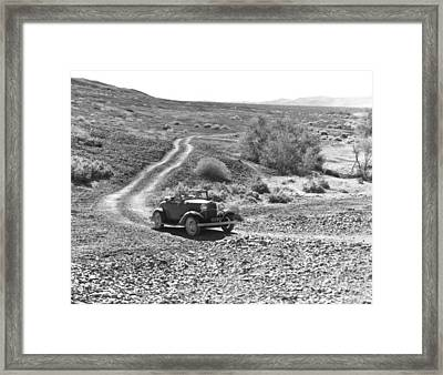 Car In The Desert Framed Print by Underwood Archives