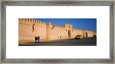 Car On A Road In Front Of A Fortified Framed Print by Panoramic Images