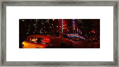 Car On A Road, Radio City Music Hall Framed Print by Panoramic Images