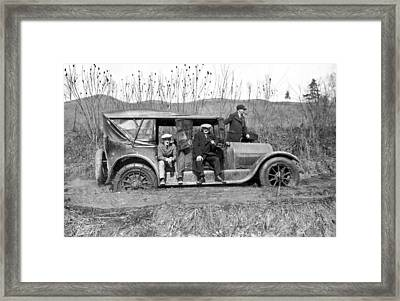 Car Stuck In Mud Framed Print by Underwood Archives