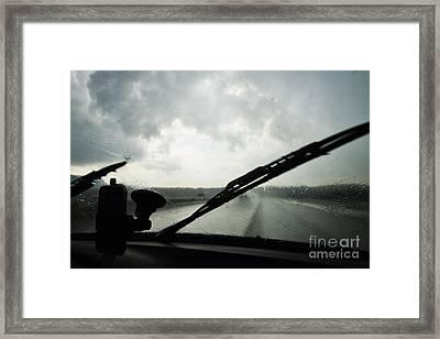 Car Windshield By Heavy Rains On Road Framed Print