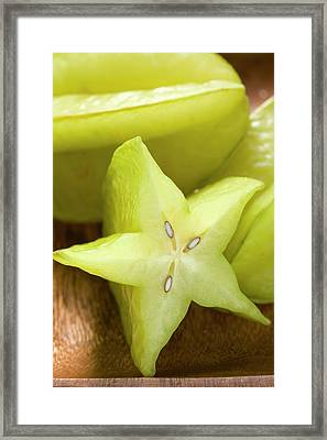 Carambolas, Whole And Halved, In Wooden Dish (close-up) Framed Print