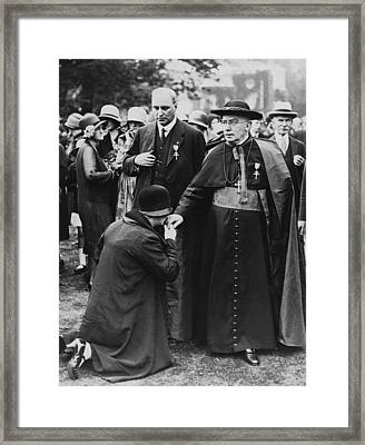 Cardinal Bourne's Hand Kissed Framed Print by Underwood Archives
