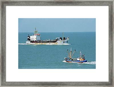 Cargo Ship And Fishing Boat Framed Print by Christophe Vander Eecken/reporters/science Photo Library