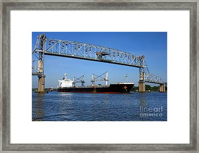 Cargo Ship Under Bridge Framed Print by Olivier Le Queinec