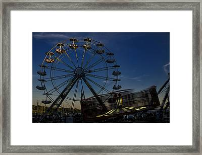 Ferris Wheel And Carnival Rides At Dusk Framed Print by John Franco