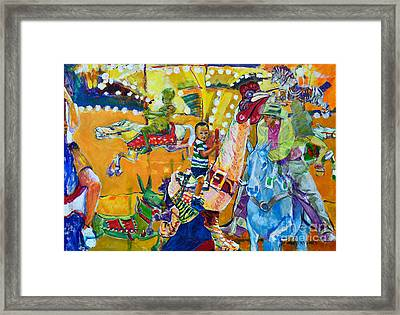 Carousel Dreams Framed Print by Charles M Williams