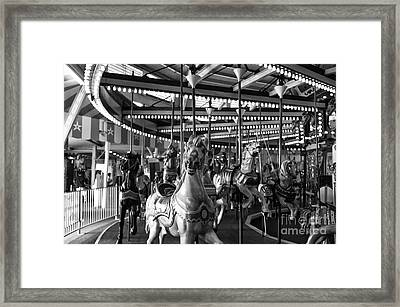 Carousel Head On Mono Framed Print by John Rizzuto