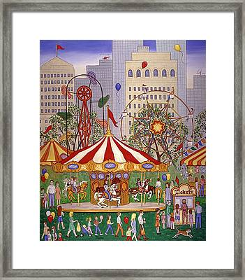 Carousel In City Park Framed Print by Linda Mears