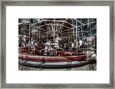 Carousel Framed Print by Wayne Sherriff