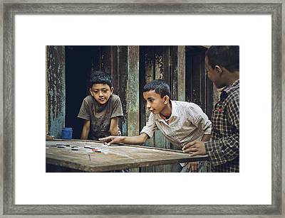 Carrom Boys Framed Print by Valerie Rosen