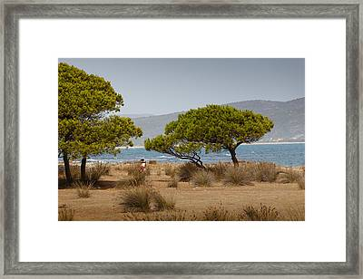Carrying Her Child Framed Print by Paul Indigo