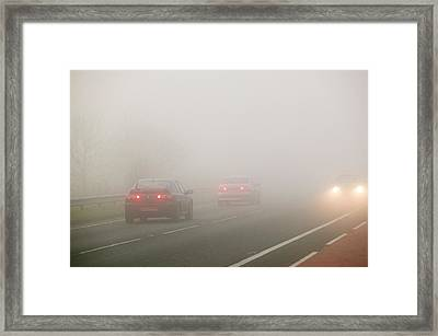 Cars Driving In Misty Conditions Framed Print by Ashley Cooper