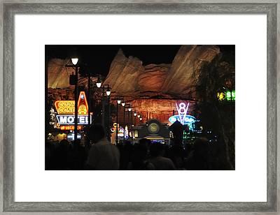 Cars Land At Night Framed Print by Jim Robinson