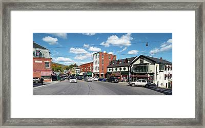 Cars Moving On The Road In A Town Framed Print
