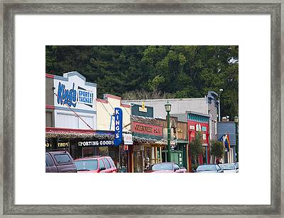 Cars Parked Outside Stores In A City Framed Print