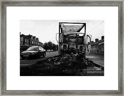 Cars Past Remains Of Burnt Out Lorry Van After Loyalist Rioting And Violence North Belfast Northern  Framed Print by Joe Fox