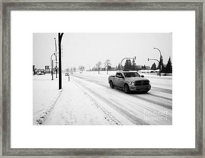cars travelling along 8th street in blizzard conditions Saskatoon Saskatchewan Canada Framed Print
