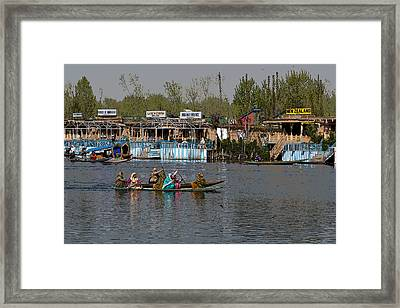 Cartoon - Ladies On 2 Wooden Boats On The Dal Lake With The Background Of Houseboats Framed Print by Ashish Agarwal