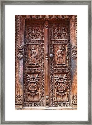 Carved Wooden Door At Bhaktapur In Nepal Framed Print by Robert Preston