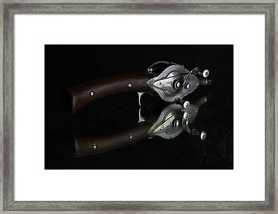 Casting Reel Framed Print by Julian Riojas