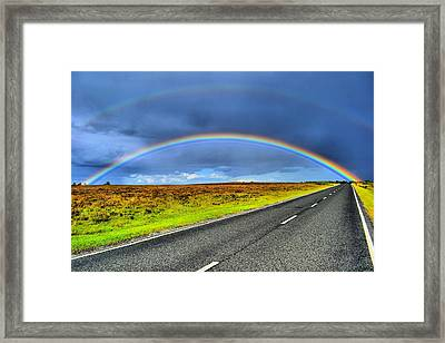 Catch The Rainbow Framed Print by Dave Woodbridge