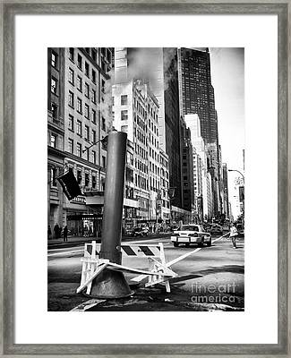 Catching A Cab Framed Print by John Rizzuto