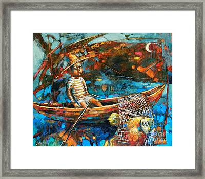 Catching A Goldfish Framed Print by Michal Kwarciak
