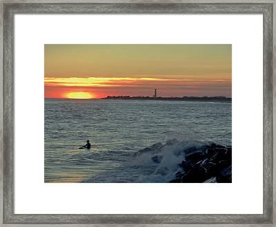 Catching A Wave At Sunset Framed Print by Ed Sweeney