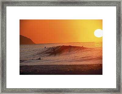 Catching A Wave At Sunset Framed Print by Vince Cavataio - Printscapes