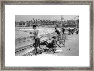 Catching More Than Fish Framed Print