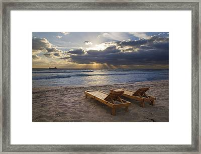 Catching Rays Framed Print by Debra and Dave Vanderlaan