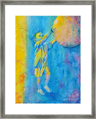 Catching The Ball Framed Print