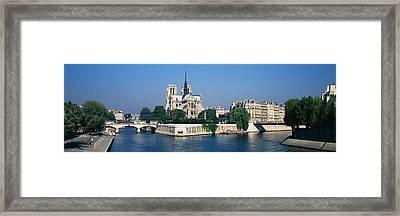 Cathedral Along A River, Notre Dame Framed Print