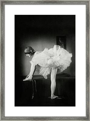 Catherine Crandell Tying Her Ballet Shoes Framed Print by Francis Bruguiere