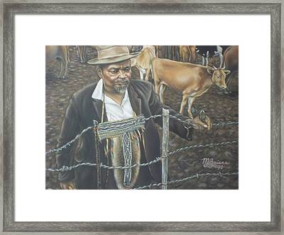 Cattle And African Rancher Framed Print by Michael Briere