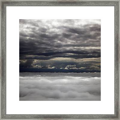 Caught Between Two Cloud Layers Framed Print by Michael Riley