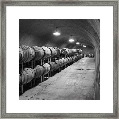 Cave Storage Of Wine Barrels Framed Print by Kent Sorensen