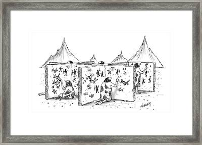 Cavemen Are Seen Carving Into Walls In The Form Framed Print by Tom Cheney