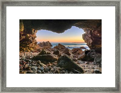 Beachside Cave Framed Print by Eddie Yerkish