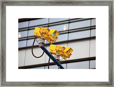 Cctv Cameras For Monitoring Traffic Framed Print by Ashley Cooper