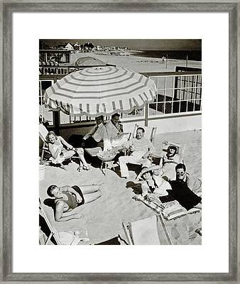 Celebrities On A Beach Framed Print