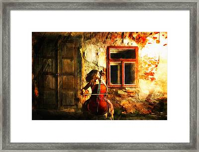 Cellist By Night Framed Print