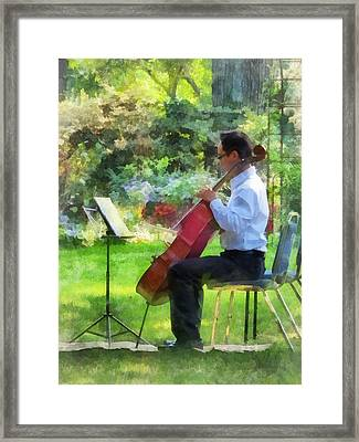 Cellist In The Garden Framed Print by Susan Savad