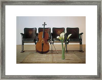 Cello Leaning On Attached Chairs Framed Print by Panoramic Images