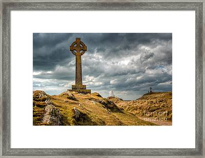 Celtic Cross At Llanddwyn Island Framed Print by Adrian Evans